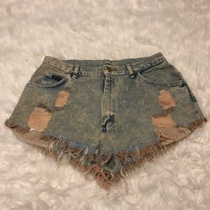 Extremely distressed wrangler cutoff shorts